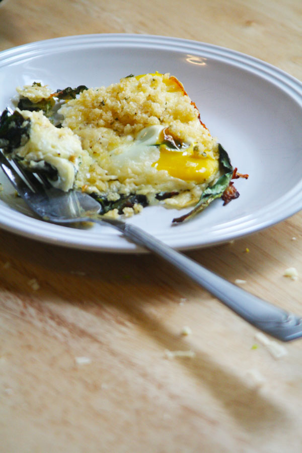 Fontina and Spinach Baked Eggs with Garlic Brown Butter Breadcrumbs | ohsodecadent.com